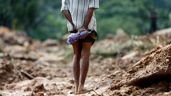 A man looks at the landslide site during a rescue mission in Athwelthota village, in Kalutara, Sri Lanka May 28, 2017. REUTERS/Dinuka Liyanawatte