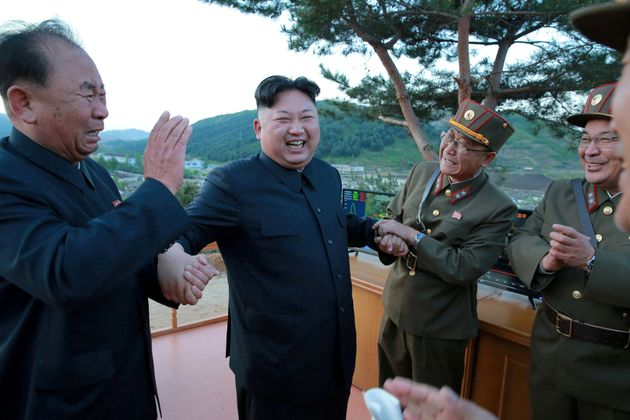 North Korean leader Kim Jong Un laughs with Ri Pyong Chol in this undated photo released by North Korea's...