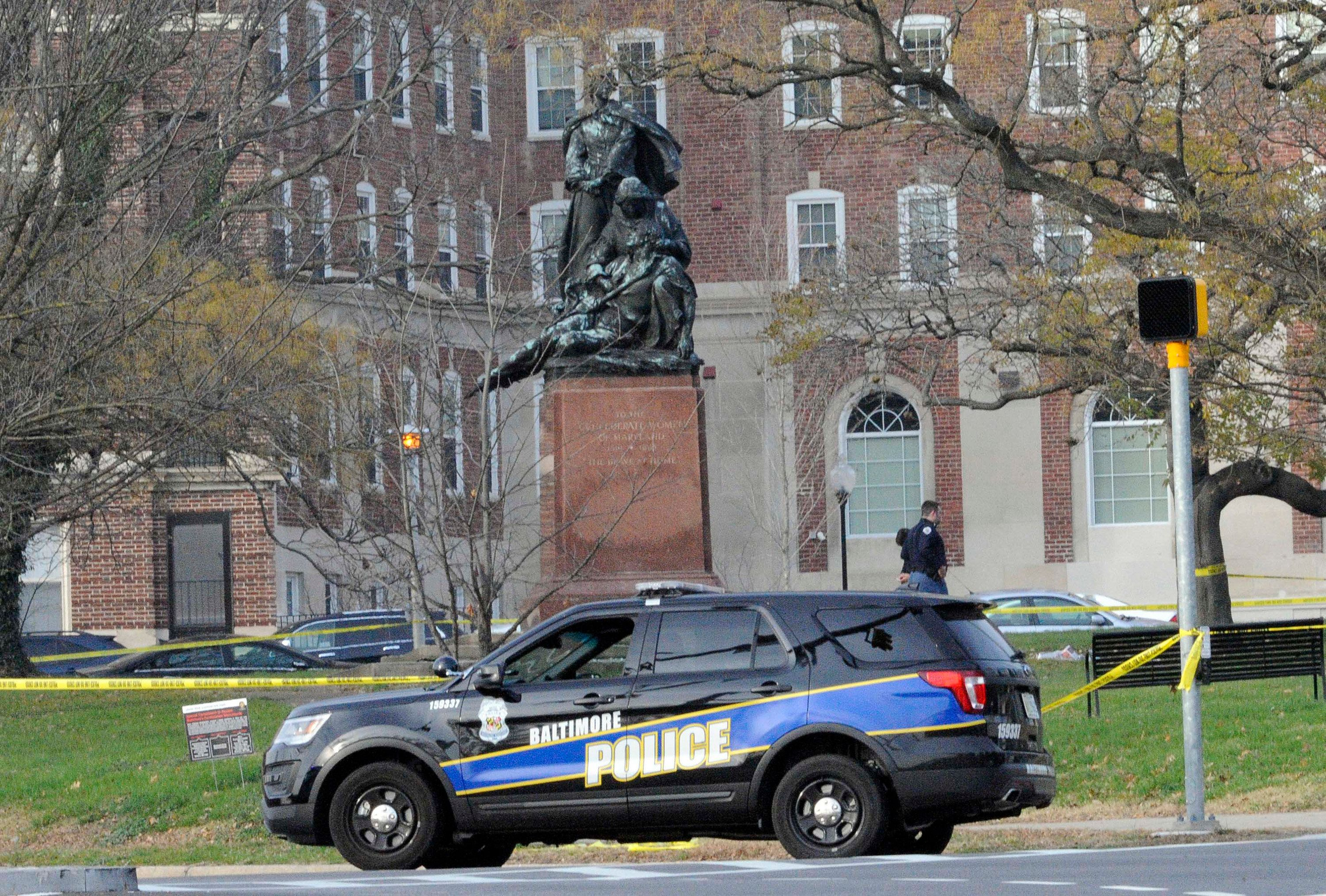 The Baltimore Police Hazard Device Unit responds to two suspicious packages that were left at the Confederate Monument in Baltimore on Saturday, Dec. 12, 2015. Both packages appeared to have newspapers and empty water bottles inside. (Jeffrey F. Bill/Baltimore Sun/TNS via Getty Images)