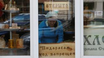 """An employee arranges products on display next to a plate reading """"No entry for faggots"""" at the German Sterligov's food store in central Moscow, Russia May 26, 2017. REUTERS/Sergei Karpukhin"""