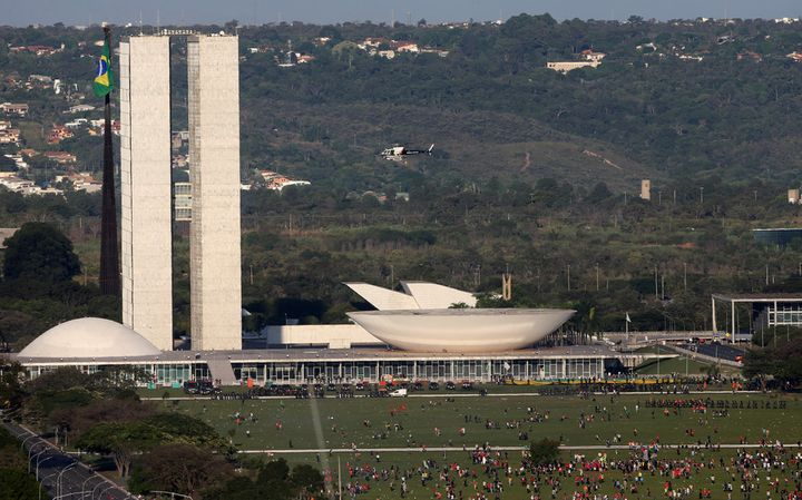 Police line up to defend Congress from protesters in the nation's capital Brasilia, while the Temer government struggles.