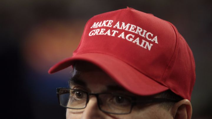 Make America Great Again hat in support of Donald Trump at a rally at Veterans Memorial Coliseum at the Arizona State Fairgro