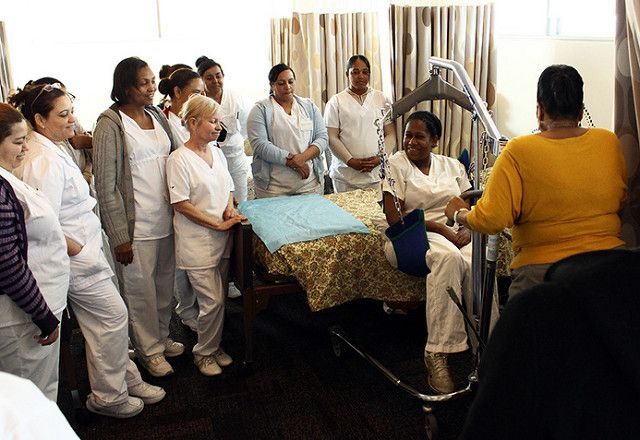 Home care workers at Cooperative Home Care Associates in New York City being trained by PHI, a national research and consulti