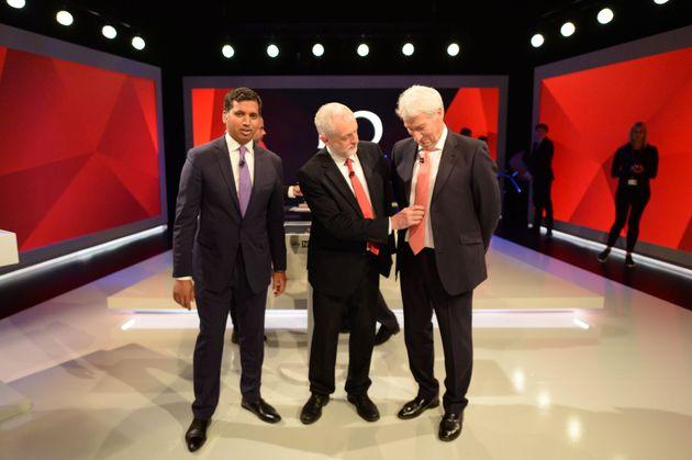 Labour leader Jeremy Corbyn adjusts the tie of Jeremy Paxman as they stand alongside Sky News political...