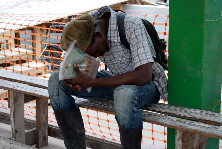 <em>October 2011 as Cholera begins to spread in the river valleys of Haiti. This young man is weeping after obtaining a chole