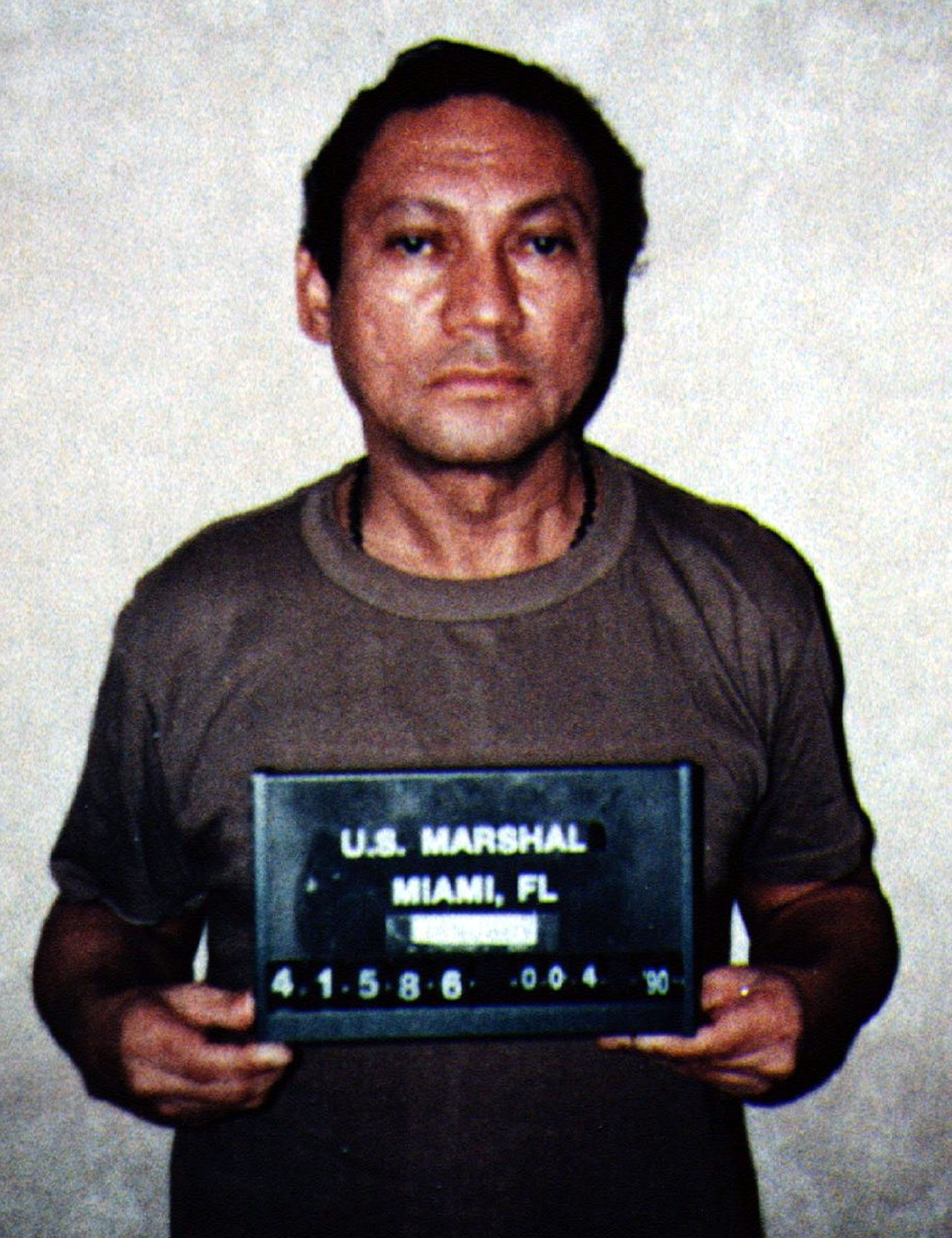 Former Panamanian strongman Manuel Noriega, pictured in this January 4, 1990 file photo, suffered a mild stroke in a U.S. prison but is in stable condition in a hospital, his attorney told CNN December 4, 2004. Miami attorney Frank Rubino told the cable news network Noriega had been taken to a Miami area hospital three days ago and although he felt tired and weak, no neurological damage had been detected, according to CNN's Web site. Rubino was out of the country and could not be reached, his secretary told Reuters. She added that staff at Rubino's high-profile Miami law firm had been told on Friday evening that Noriega had simply gone for a routine medical check-up. Noriega is shown in this file photo taken during his arrest by U.S. Drug Enforcement Agency agents in 1990. REUTERS/HO  JDP