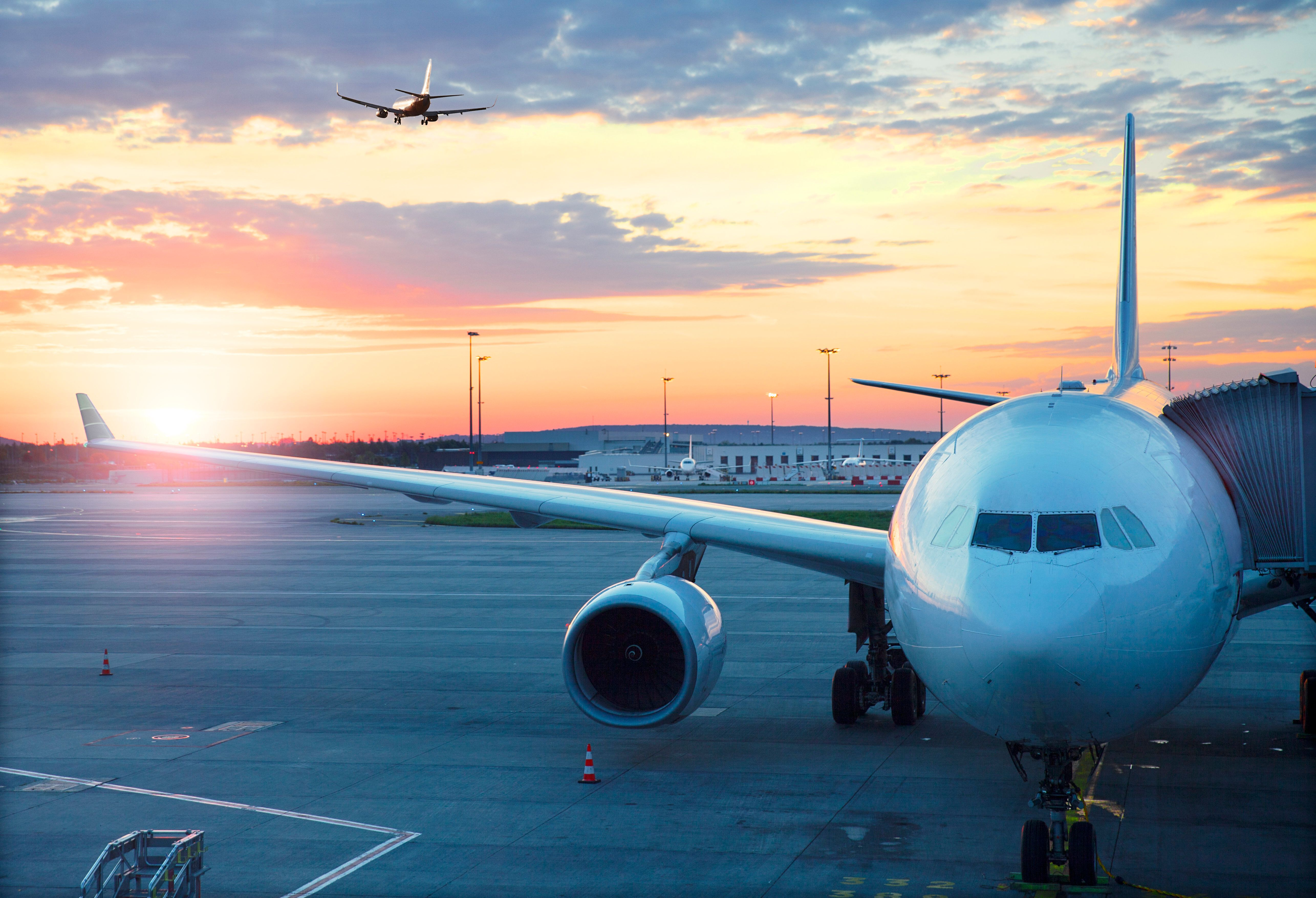 Charles De Gaulle , International airport in Paris -  Airplane at sunrise.