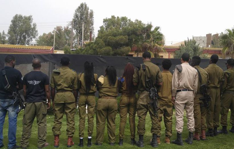Soldiers from the African Hebrew Israelite community turn their backs to protest the Israeli army's handling of Toveet's case