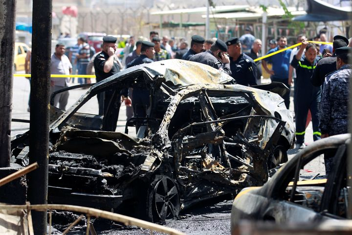 A wreckage of a car is seen at the site of car bomb attack near a government office in Karkh district in Baghdad.