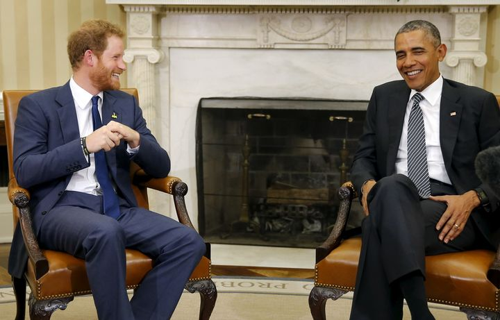 Former U.S. President Barack Obama talks to Britain's Prince Harry during a meeting at the Oval Office at the White House on October 28, 2015