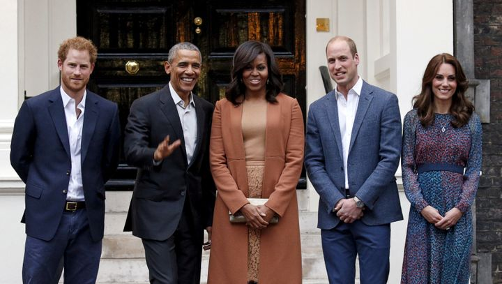 Former U.S. President Barack Obama and first lady Michelle Obama pose with Britain's Prince William, his wife Catherine, Duchess of Cambridge, and Prince Harry, upon arrival for dinner at Kensington Palace in London on April 22, 2016.