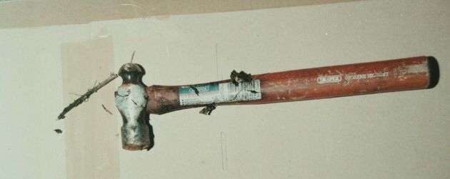 A Kent Police picture of a hammer found in a hedgerow bordering a field near the scene of the