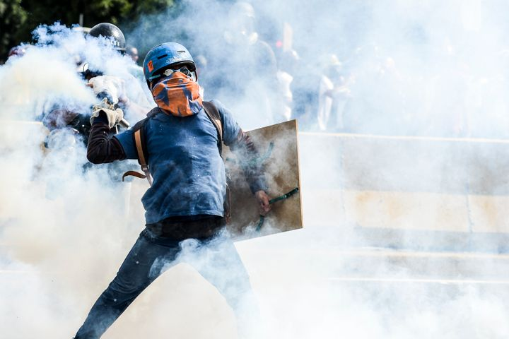 Opposition activists and riot police clash during a demonstration against Maduro. Caracas, May 29.