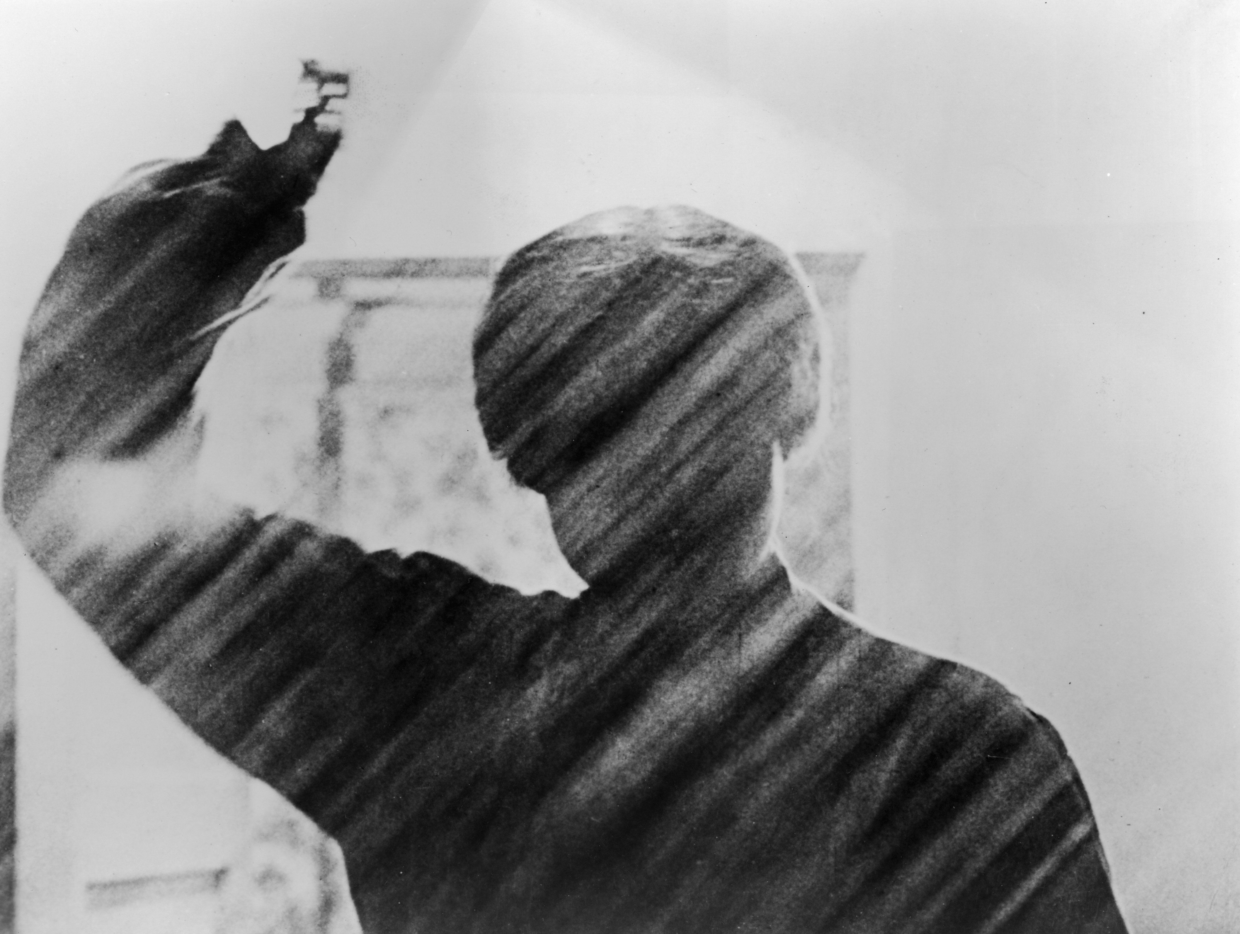 View of a silhouetted figure holding a knife in the famous shower scene from the film, 'Psycho,' directed by Alfred Hitchcock, 1960. (Photo by Paramount Pictures/Courtesy of Getty Images)
