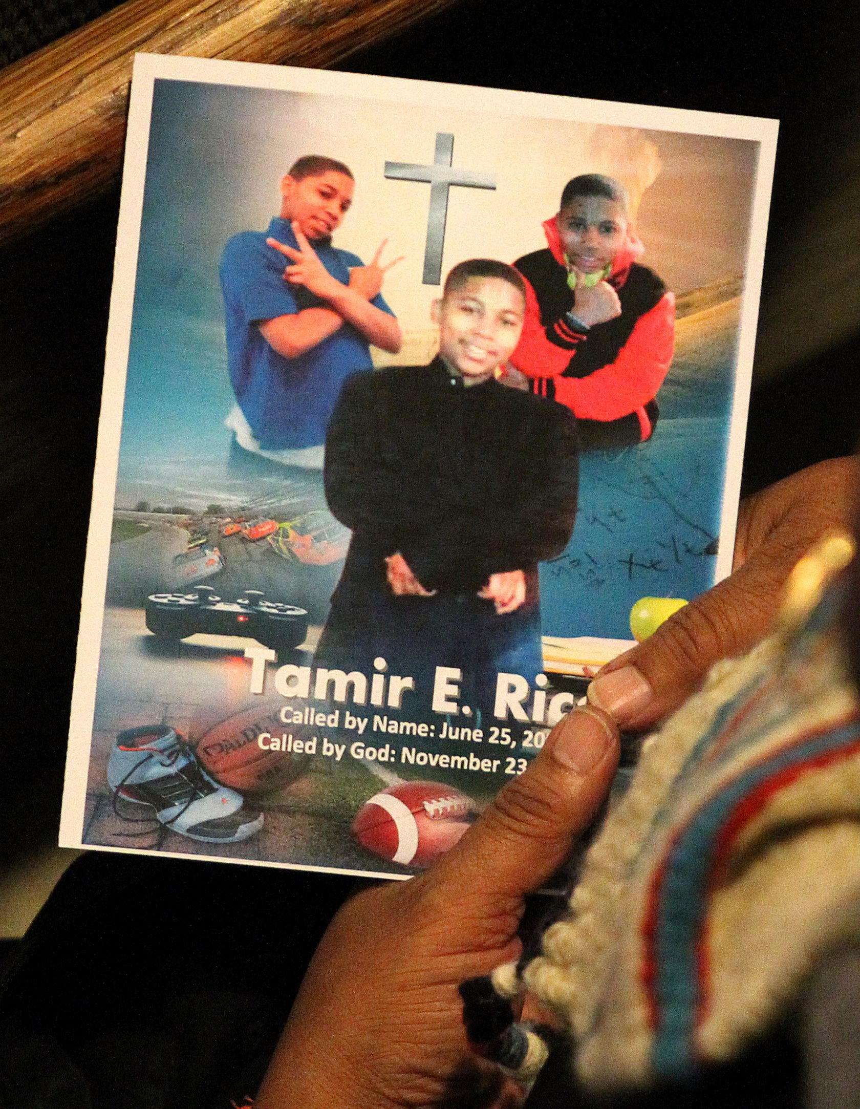 A mourner looks at a program during the funeral service for Tamir Rice in Cleveland on Dec. 3, 2014.