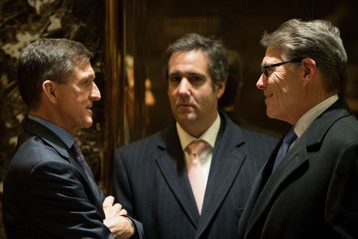Retired Lt. Gen. Michael Flynn (left), Michael Cohen (center) and former Texas Gov. Rick Perry (right) talk with each ot