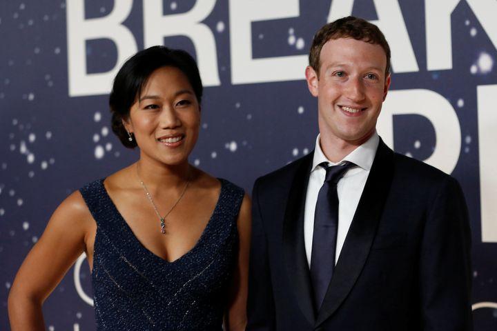 Mark Zuckerberg (R), founder and CEO of Facebook, and wife Priscilla Chan.