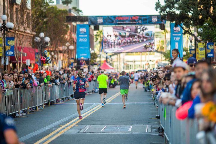 <p>Runners head toward the finish line at the San Diego Half-Marathon.</p>
