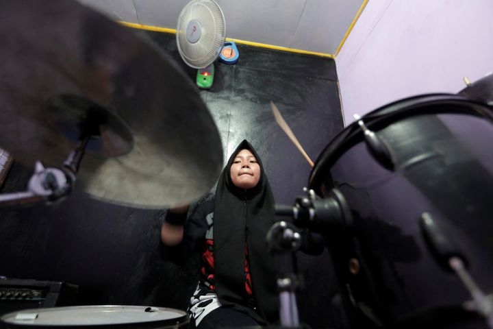Euis Siti Aisyah, a member of the metal Hijab band Voice of Baceprot, practices at a studio before she performs in Garut, Ind