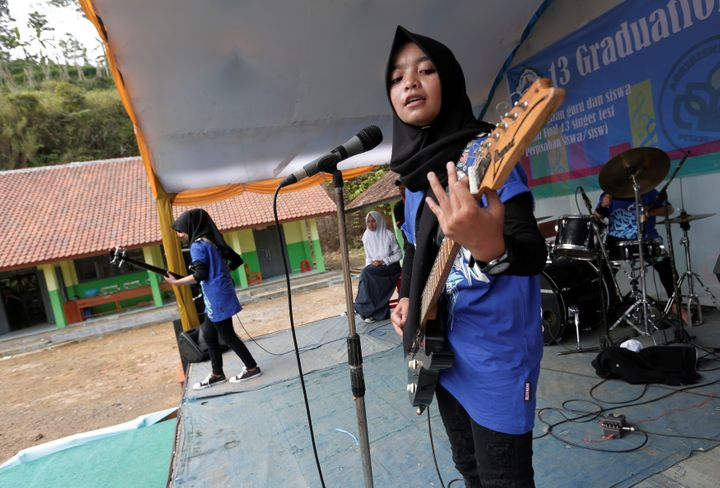 Firdda Kurnia, leader of the metal Hijab band Voice of Baceprot, performs during a school's farewell event in Garut, Indonesi