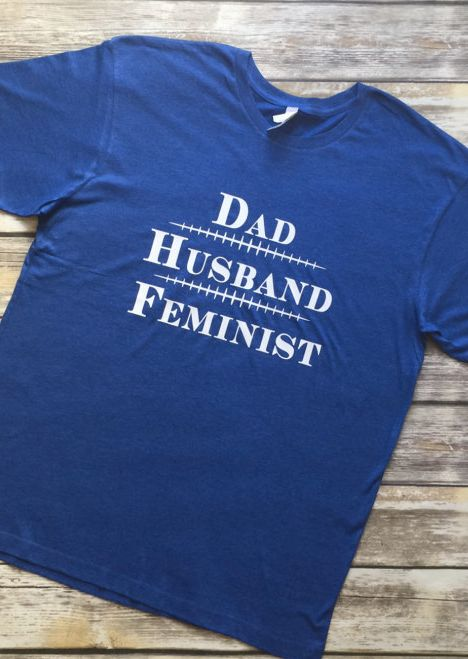 "$20 and up, Etsy/Starheel Studios. <a href=""https://www.etsy.com/listing/498379386/dad-husband-feminist-shirt?ga_order=most_r"