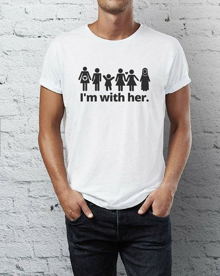"$22, Etsy/Fourth Wave Apparel. <a href=""https://www.etsy.com/listing/494736002/feminist-mens-shirt-im-with-her-multiple?ga_or"