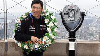 Takuma Sato, winner of the 101st running of the Indianapolis 500 and driver of the #26 Ruoff Home Mortgage Honda poses as he visits the Empire State Building May 30, 2017 in New York, following his victory in Sundays historic race.  Sato became the first Japanese driver to win The Greatest Spectacle in Racing when he edged three-time Indy 500 winner Helio Castroneves to the finish line by 0.2011 of a second. / AFP PHOTO / TIMOTHY A. CLARY        (Photo credit should read TIMOTHY A. CLARY/AFP/Getty Images)