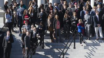 White House staffers stand on the steps of the Eisenhower Executive Office Building as they await the arrival of US President-elect Donald Trump for a meeting with US President Barack Obama at the White House in Washington, DC, November 10, 2016. / AFP / SAUL LOEB        (Photo credit should read SAUL LOEB/AFP/Getty Images)