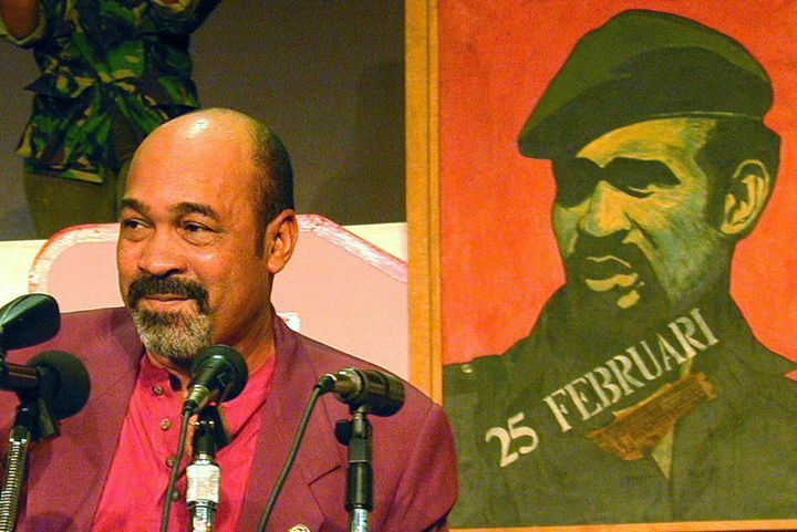 Surinamese's President Desi Bouterse in 1996, speaking in front of a portrait of himself from back in his military strongman