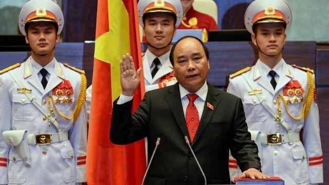 <em>Nguyen Xuan Phuc being sworn in as Vietnam</em>'s <em>prime minister, 2016.</em>