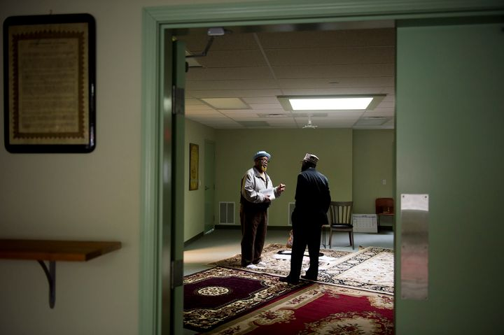 Imam Mikal Shabazz, right, and his brother Omar Shabazz, right, talk at the Muslim Community Center of Portland on May 30, 20