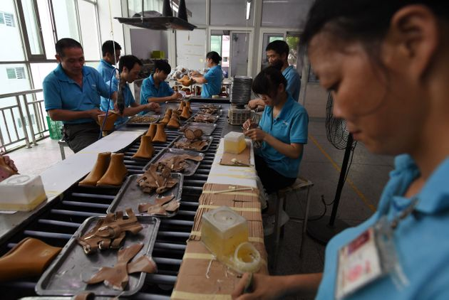 Workers on a production line at the shoe factory in south China's Guangdong