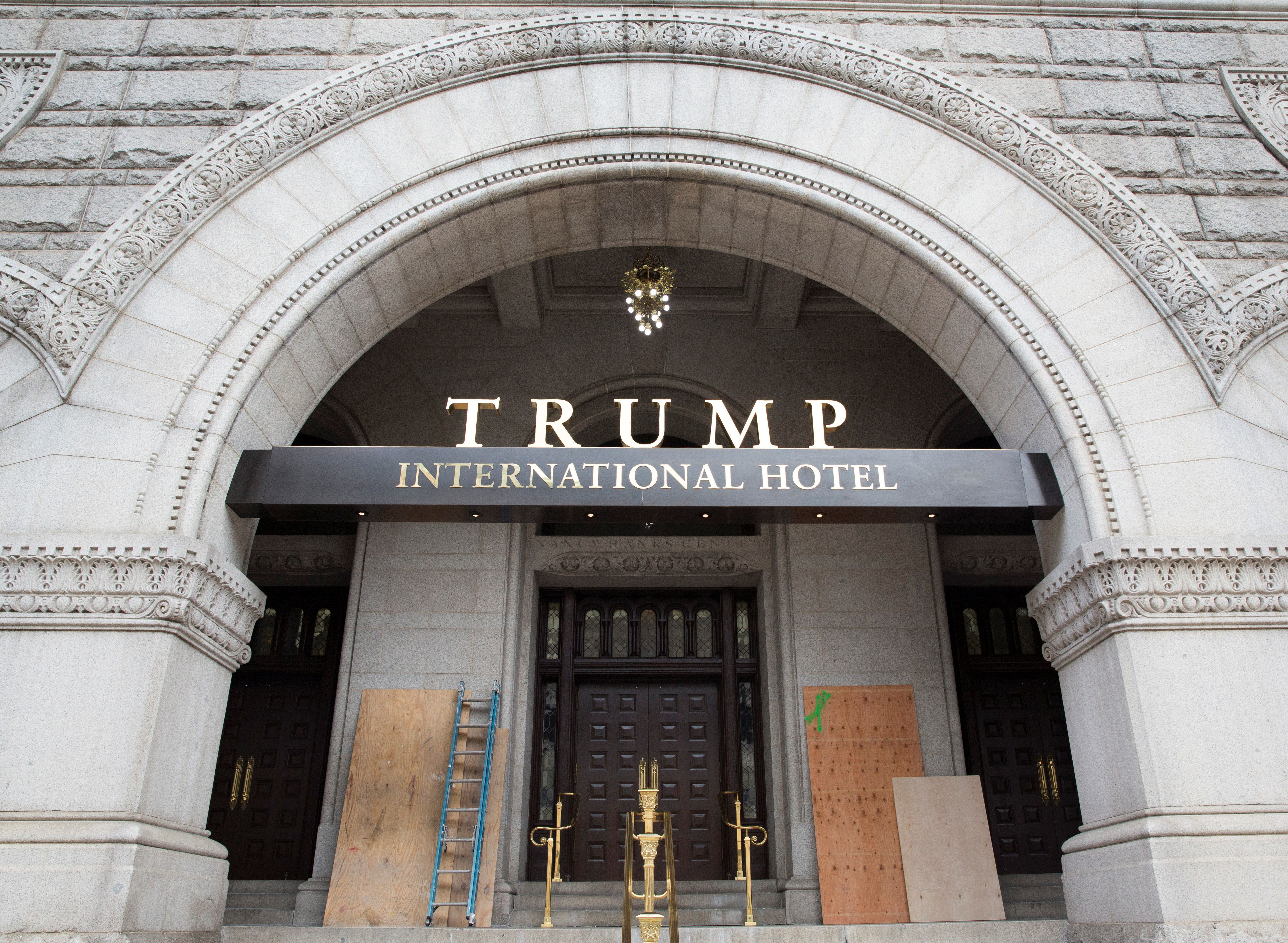 Plywood covers graffiti at an entrance to the Trump International Hotel in Washington, U.S., October 2, 2016.    REUTERS/Joshua Roberts
