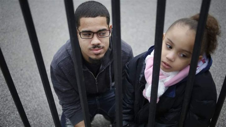 Luis Padilla with his daughter, Isabella, near their home in New York. Padilla was arrested at 16 and sent to Rikers Island.