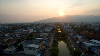 CHIANG MAI, CHAING MAI, THAILAND - 2017/04/11: (EDITORS NOTE: Image has been created using a drone.) Aerial drone view of sunset over the moat in the Old City of Thailand' second largest city Chiang Mai. (Photo by Stephen J. Boitano/LightRocket via Getty Images)