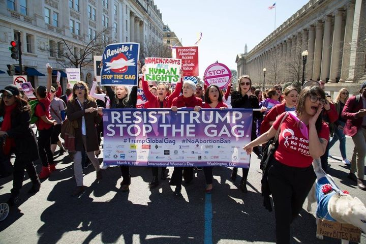 Protestors marched to the White House on International Women's Day to resist Trump's deadly global gag rule.