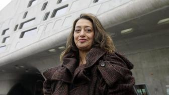 WOLFSBURG, Germany:  Iraqi-born London-based architect Zaha Hadid poses in front of the building housing the 'Phaeno' Science Center and museum in Wolfsburg 23 November 2005. The building, which has 9.000 square meters of exhibition space, will house a science center where people will be able to 'experience' scientific experiments. The center, built at a cost of EUR 80 million, will be inaugurated 25 November 2005. AFP PHOTO DDP/JOCHEN LUEBKE     GERMANY OUT  (Photo credit should read JOCHEN LUEBKE/AFP/Getty Images)