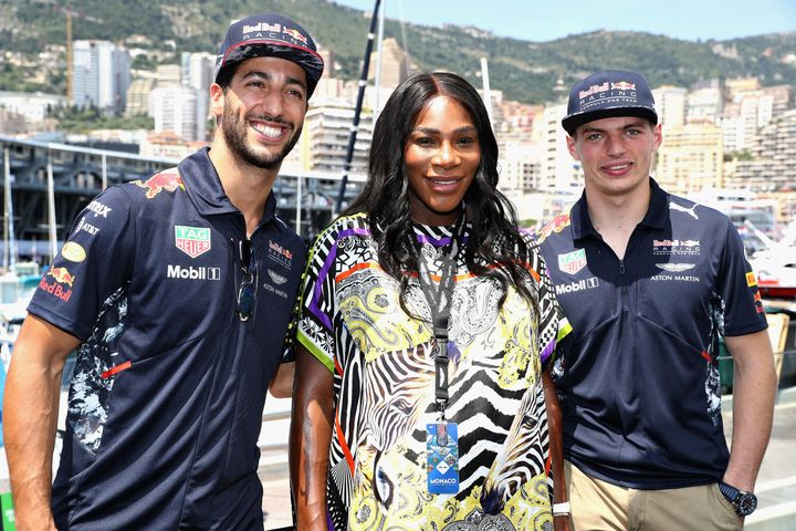 Tennis superstar Serena Williams with Daniel Ricciardo of Australia and Red Bull Racing and Max Verstappen of Netherlands and Red Bull Racing during the Monaco Formula One Grand Prix at Circuit de Monaco on May 28.