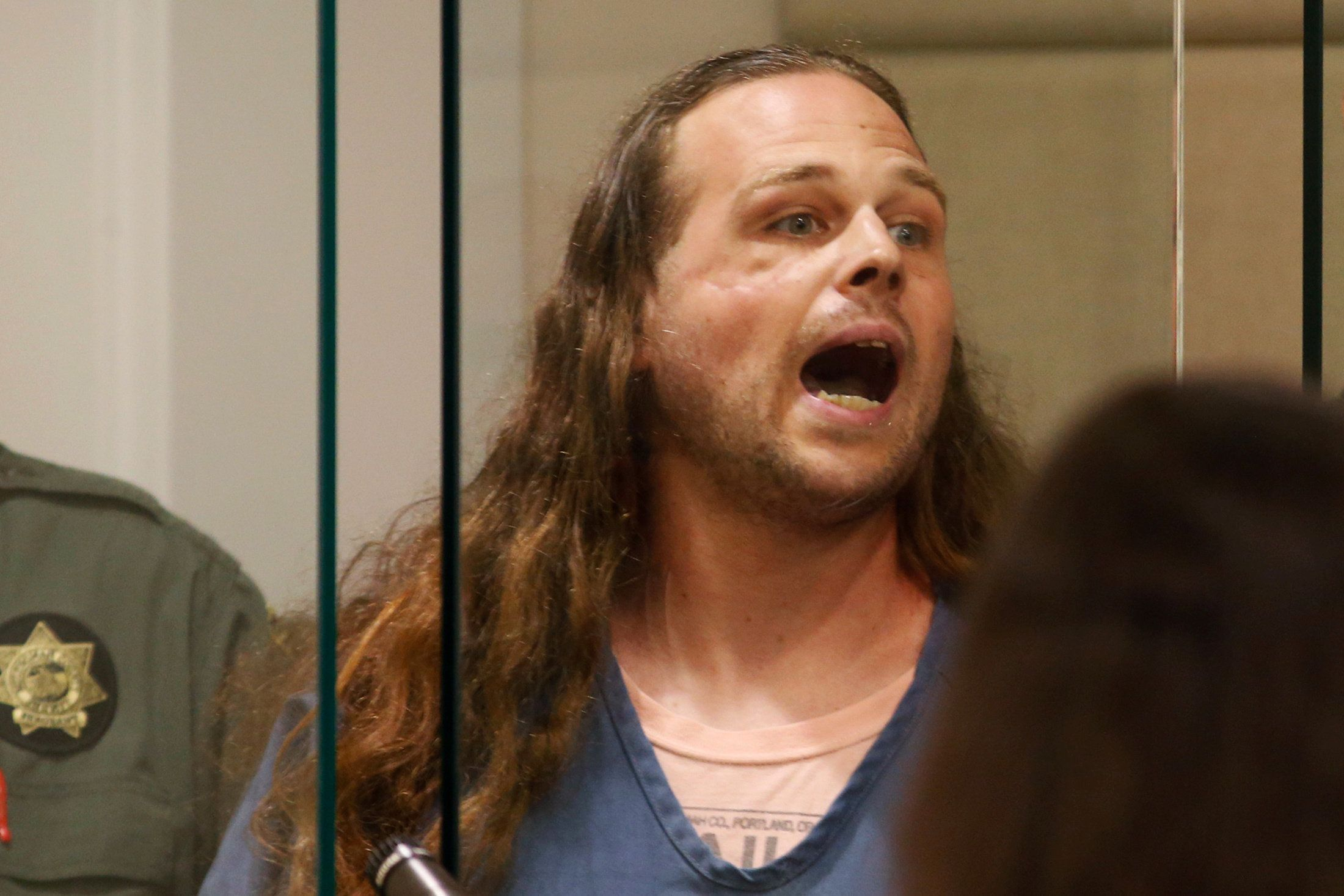 Jeremy Christian, accused of killingtwo men on a train, shouts in Multnomah County Circuit Court in Portland on May 30.