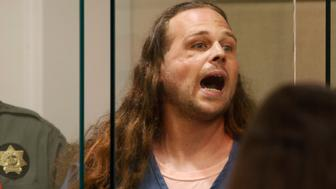 A convicted felon, Jeremy Christian, 35, accused of fatally stabbings two Good Samaritans who tried to stop Christian from harassing a pair of women who appeared to be Muslim, shouts during an appearance in Multnomah County Circuit Court in Portland, Oregon, U.S., May 30, 2017.   REUTERS/Beth Nakamura/Pool    TPX IMAGES OF THE DAY