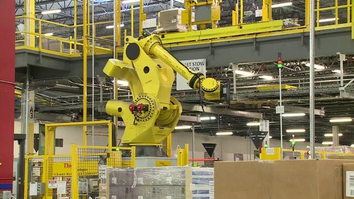 Part of Amazon's secret sauce to make this happen is robots. (above)