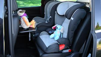 Side shot on the seats for children mounted in minivan.