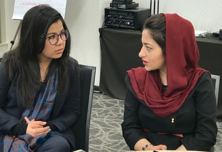 Mina Naikmal (right) discusses her project with coach Mariam Ghaznavi. Coaches are selected from previous Fellowship graduate