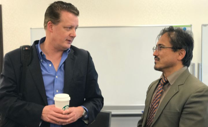 Microsoft's Michael Fors, one of the founders of the UNITAR program, chats at a class break with Dr. Abdul Bashir, one of the