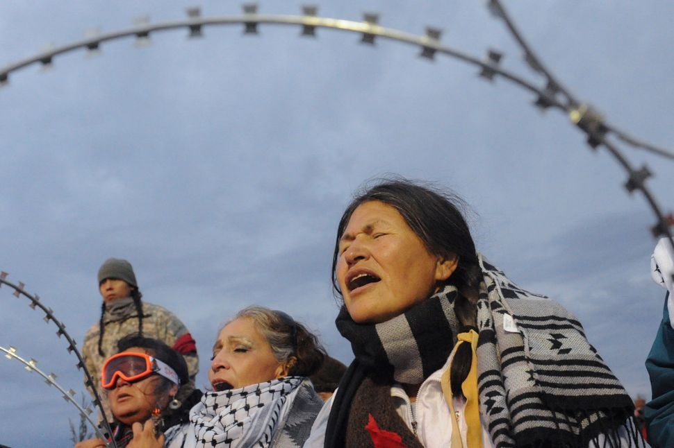 Women hold a prayer ceremony.