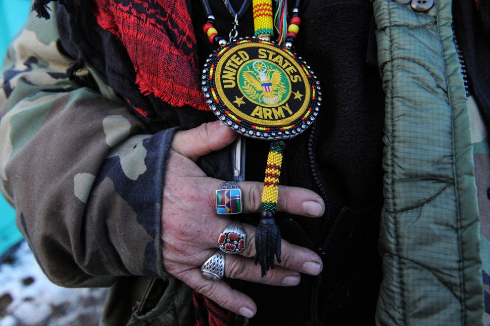 Steve Perry from the Odawa tribe displays his Army medal for the camera in Oceti Sakowin camp.