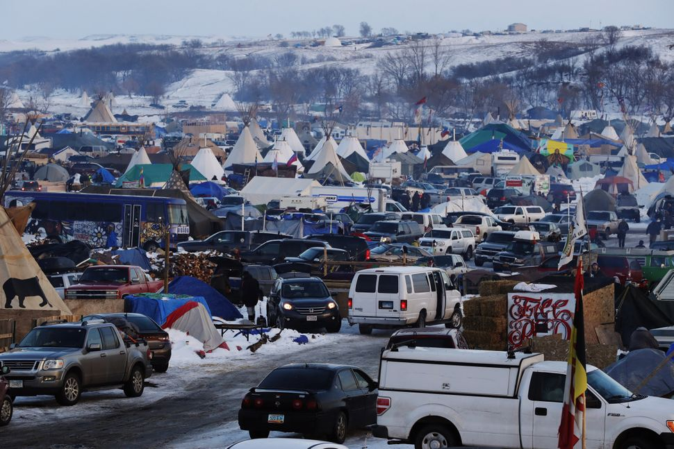 Vehicles and campsites fill the Oceti Sakowin camp.