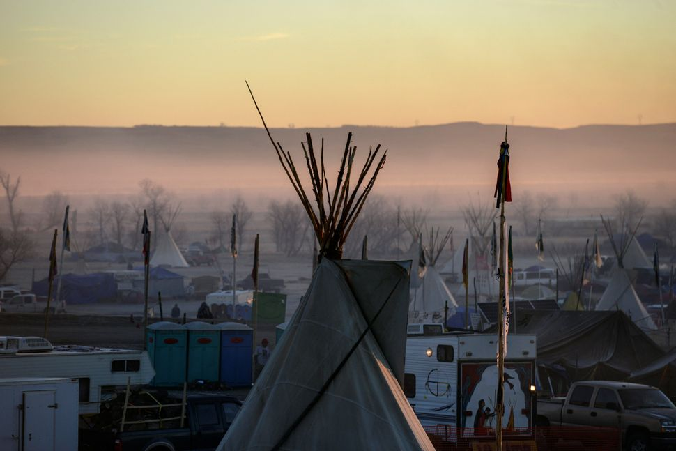 A tipi is seen at sunrise at an encampment.