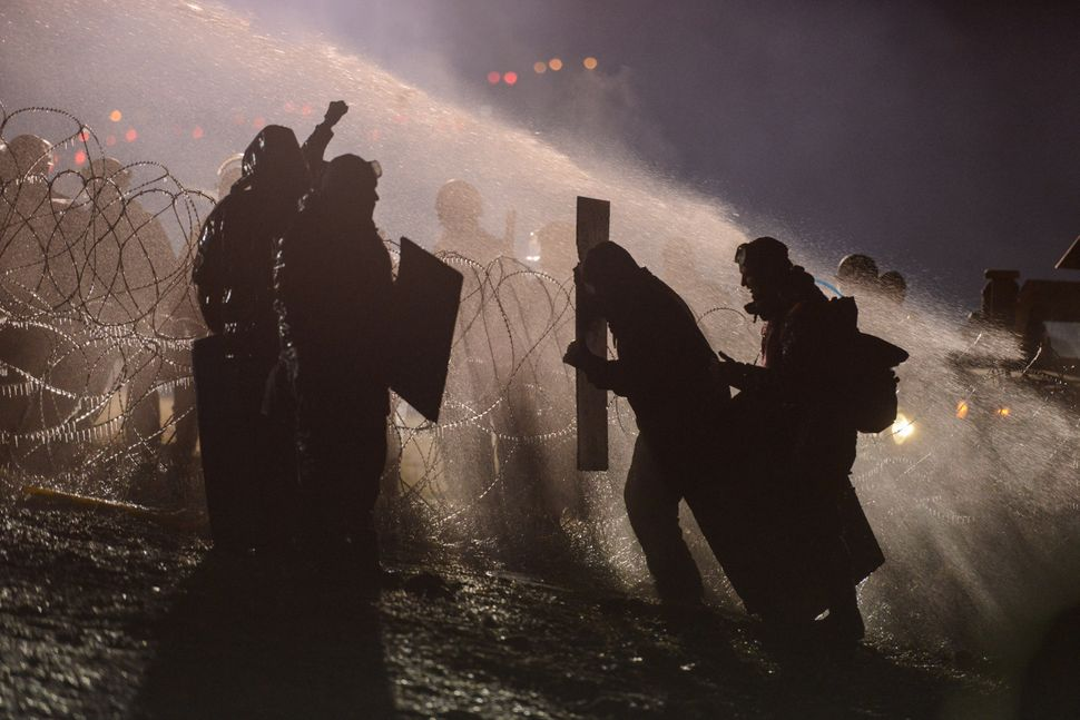 Police use a water cannon on protesters near the Standing Rock Indian Reservation.