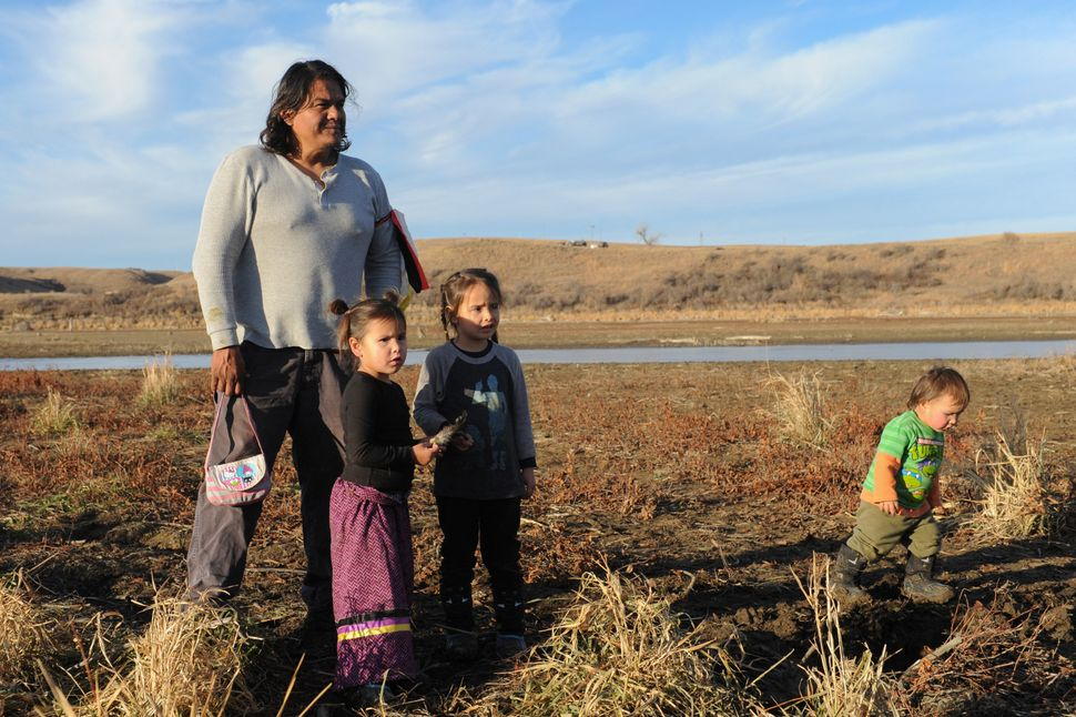 A family from the Cheyenne River tribe plays together near Turtle Island during a protest.